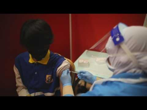 Malaysia vaccinates youth under 18 in efforts to contain pandemic