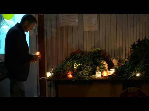 Russians mourn campus shooting spree victims with candles, flowers