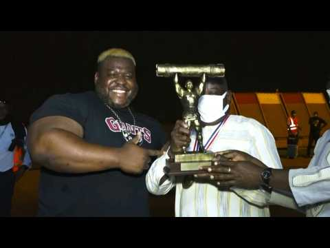 Pumping Iron: Burkinabe Strongman arrives home after breaking log-lifting record