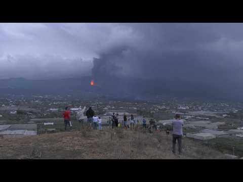 Spain: Canary Islanders watch as lava flows from volcano