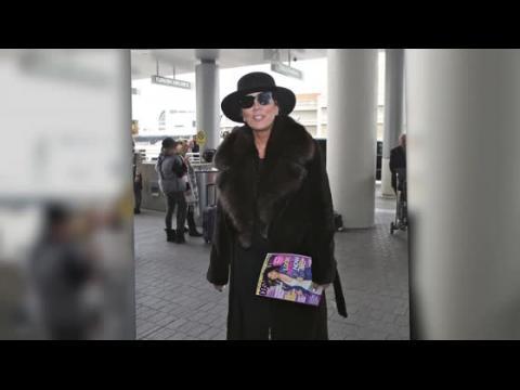 Kris Jenner profite de son voyage pour en faire une séance de pub