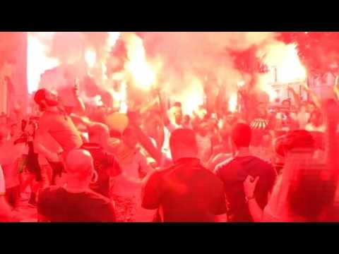 Fans celebrate Algeria's first goal in Marseille