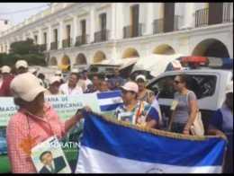 Madres de migrantes siembran árboles en cementerio de Juchitán