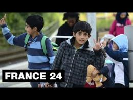Europe migrant crisis: refugees arrive in France, and with them, the first critics