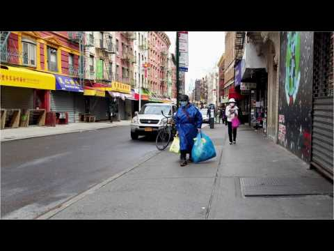 Locals are seen walking in Chinatown, New York City in 2020