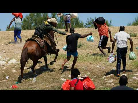 Photos of US border agents appearing to swing reins at Haitian migrants trigger investigation