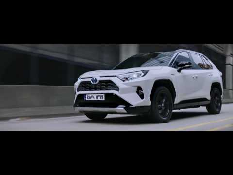 The new Toyota RAV4 Hybrid Day Driving in the City