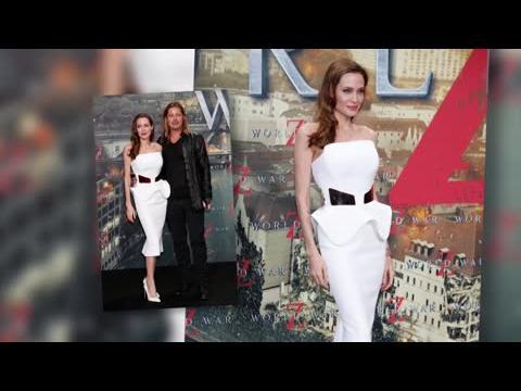 La star du jour Angelina Jolie, magnifique en blanc à une première en Allemagne avec Brad Pitt