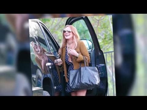 Lindsay Lohan a l'air heureuse en quittant sa cure