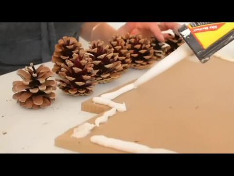 fabriquer un sapin mural en pommes de pin pour no l sur orange vid os. Black Bedroom Furniture Sets. Home Design Ideas