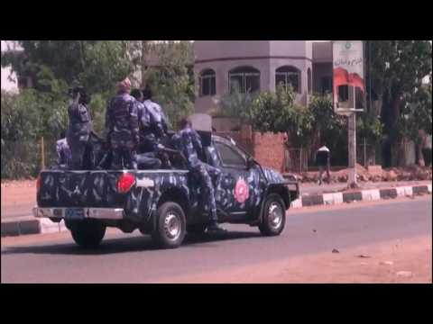 Sudan police try to clear roads as protesters barricade streets
