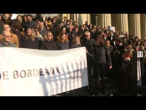 Lawyers protesting pension reform throw their robes onto courthouse steps