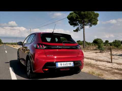 The new Peugeot e-208 Allure in Elixir Red Driving Video