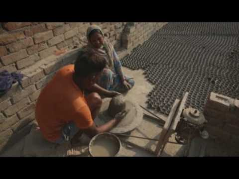 Indian artisans ramp up clay lamps production ahead of Hindu festival of Diwali