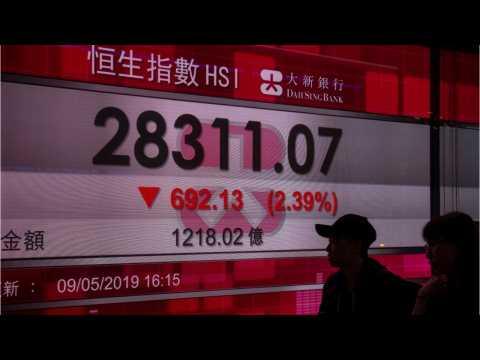 Asian Shares Falter, Dollar Jumps As Powell Dampens Hopes