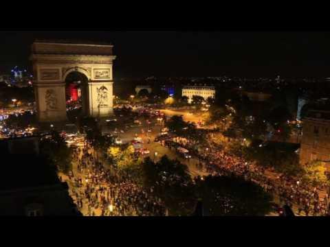 Algerians celebrate team's win on the Champs Elysées