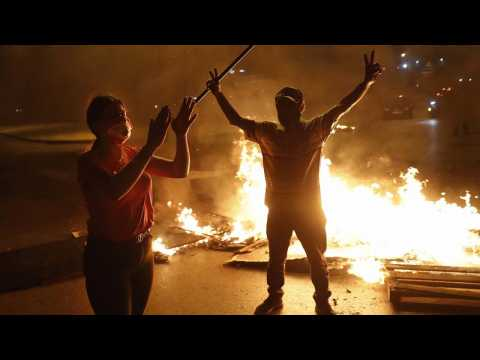 Lebanon: Beirut wakes up to damage after clashes as currency hits new low