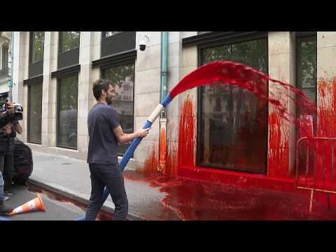 Extinction Rebellion sprays Medef employers' association HQ in Paris with fake blood