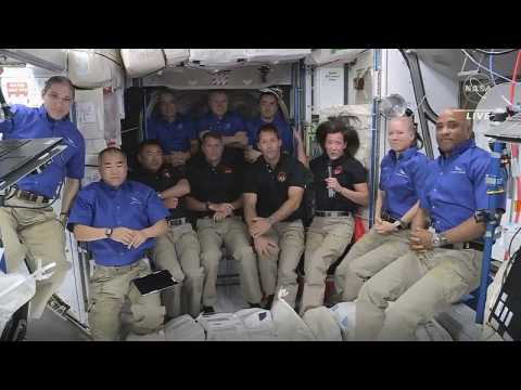 Four astronauts on Elon Musk's SpaceX capsule dock at International Space Station