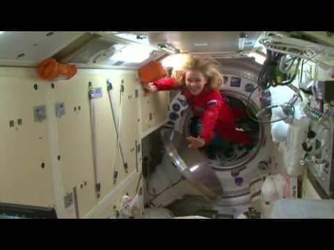 Russian crew arrives at the ISS to film first movie in space