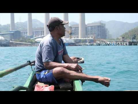Coal-fired power plant looms over Indonesian village