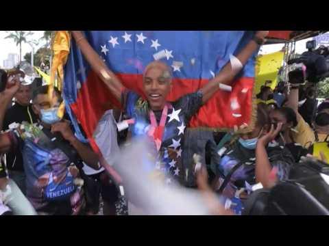 Triple jump gold medallist Rojas parades through Caracas