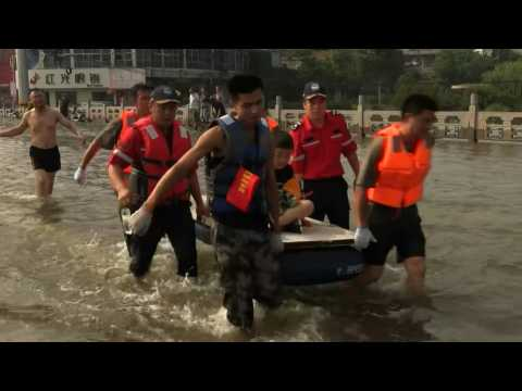Locals rafted to safety in central China during deadly flooding
