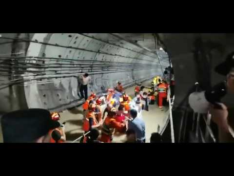 Firefighters rescue trapped passengers from flooded subway in China
