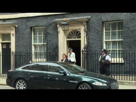 Theresa May leaves cabinet meeting day after top ministers quit