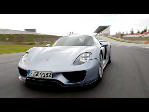 Porsche 918 Spyder & Panamera Turbo S E-Hybrid Sport Turismo in Carrara White Metallic on the track