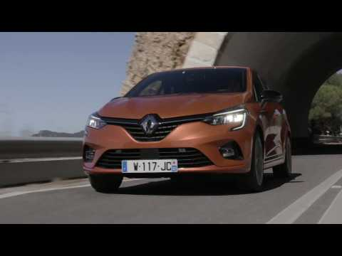 2019 All-new Renault CLIO in Orange Valencia Driving in Portugal