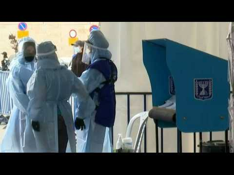 Electoral workers wear PPE at drive through polling station for quarantined voters