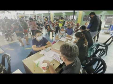Filipinos affected by COVID-19 lockdown flock to financial aid centers