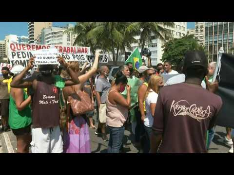 People protest in Rio against virus measures