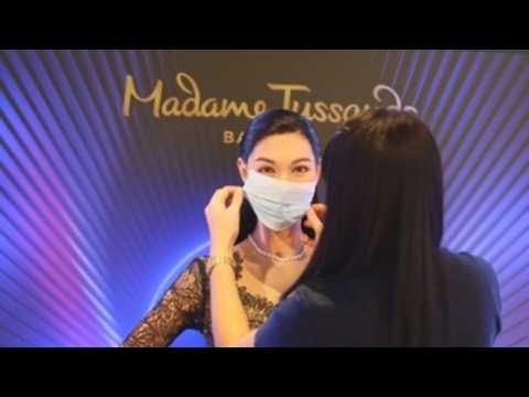 Madame Tussauds Bangkok's wax figures don masks to help fight COVID-19