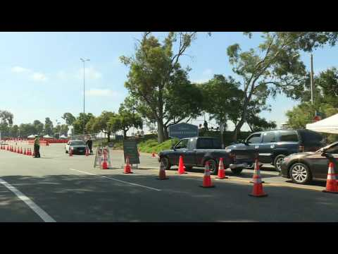 Cars line up at COVID-19 testing site in Los Angeles as cases surge