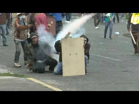 Protesters and police clash again in Ecuador capital