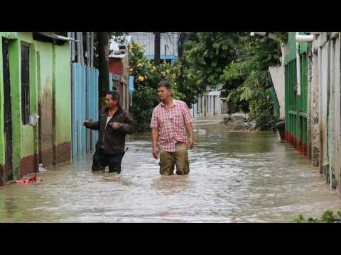 Homes and businesses submerged in flooding in northern Honduras