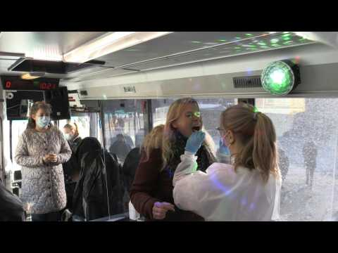 In Denmark, party bus turns into mobile Covid-19 testing centre