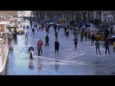 Dutch ice skaters take advantage of frozen canals and lakes amid northern Europe's deep freeze