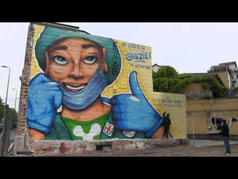 Street artist paints mural to thank doctors and nurses in Milan