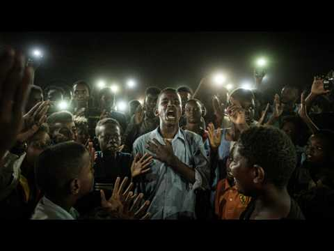 AFP's Yasuyoshi Chiba wins top World Press Photo prize for Sudan protest picture