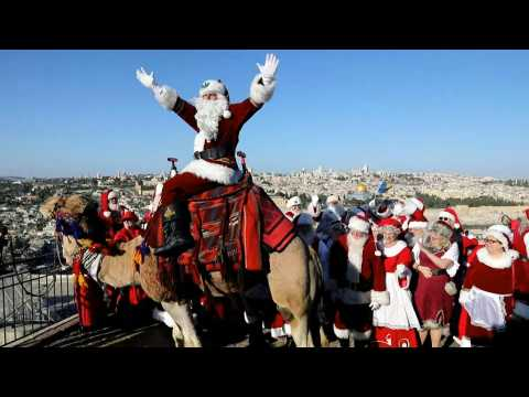 Tourists dressed as Santa hit Jerusalem for Orthodox Christmas