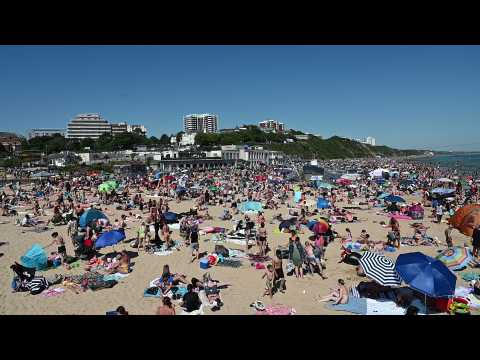 Thousands crowd English beach town as heatwave hits restriction-weary Europe