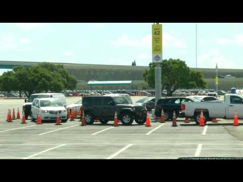 Long line of cars wait at coronavirus drive-through testing site in Miami