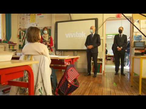 French education minister visits school near Paris