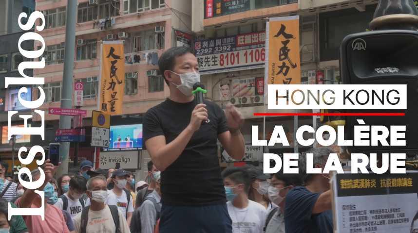 Illustration pour la vidéo Des milliers de Hongkongais défient Pékin et sa nouvelle loi sur la sécurité