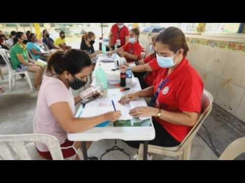 Mothers affected by COVID-19 pandemic receive cash assistance in Philippines