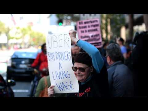 Uber and Lyft drivers strike over pay and working conditions