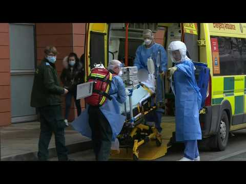 Covid patient arrives at London hospital as UK records over 100,000 deaths